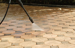 Cleaning concrete block floor Royalty Free Stock Photo