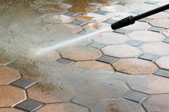 Cleaning concrete block floor. By high pressure water jet stock images