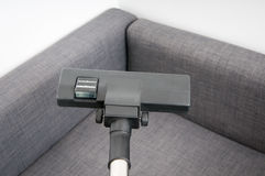 Cleaning the couch. Vacuum cleaning the couch with the right powerful tool Stock Images