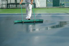 Cleaning crew drying tennis court Stock Photos
