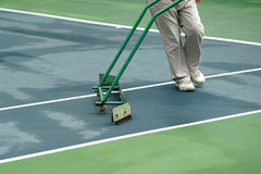 Cleaning crew drying tennis court Royalty Free Stock Images