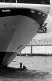 Cleaning a cruise ship. Workmen cleaning the hull of a large cruise ship Royalty Free Stock Image