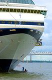 Cleaning a cruise ship hull. Performing cleaning on the hull of a cruise ship Stock Photo