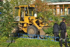 Cleaning of the cut branches of trees by means of a tractor. Royalty Free Stock Photos