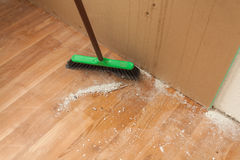 Cleaning debris on floor by brush Royalty Free Stock Photos