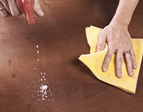 Cleaning dining table Stock Images