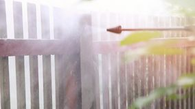 Cleaning dirty concrete fence post with high pressure washer stock video
