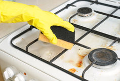 Cleaning of dirty gas stove burner. S in kitchen room Stock Images