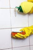 Cleaning of dirty old tiles in a bathroom Royalty Free Stock Photography