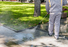Cleaning dirty streets with high pressure Stock Photo