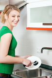 Cleaning the dishes Stock Photos