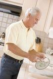 cleaning dishes man Στοκ Φωτογραφία