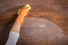 Cleaning with dishrag Royalty Free Stock Images