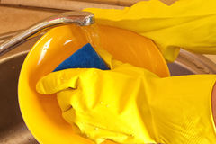 Cleaning dishware kitchen sink sponge Stock Photography