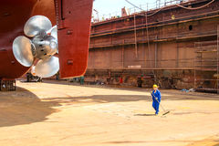 Cleaning the dock prior to immersion Royalty Free Stock Photo