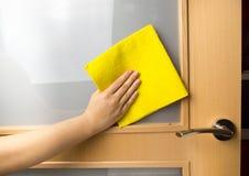 Cleaning the door Stock Photo