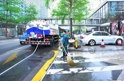 Cleaning downtown area Royalty Free Stock Photo