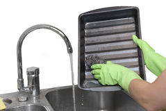 Cleaning dripping pan. With scraper Stock Photo