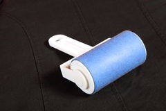 Cleaning dust with lint roller Stock Image