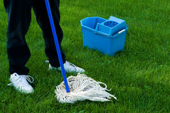 Cleaning The Earth. Somebody using a mop and pail to clean up the Earth stock photography