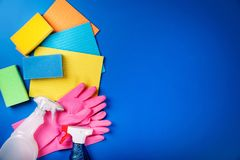 Cleaning equipment on blue background Royalty Free Stock Image