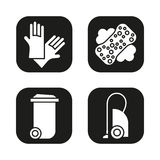 Cleaning equipment icons set. Vacuum cleaner, trash can, sponge with foam and latex gloves. Vector white silhouettes Stock Photography