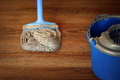 Cleaning equipment on wooden floor Stock Photo