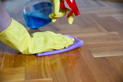 Cleaning equipment and wooden parquet Stock Photography