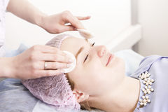 Cleaning face in beauty salon Stock Photography