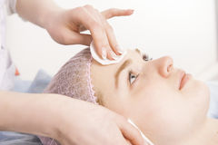 Cleaning face in beauty salon Stock Image