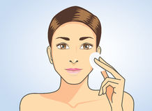 Cleaning face skin with facial cotton stock illustration