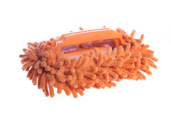 Cleaning facilities. Cleaning supplies. orange soft brush on the handle Royalty Free Stock Photo