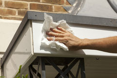 Cleaning Fascia. Cleaning PVCu fascia board after installation Stock Photography
