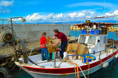 Cleaning fishing net Stock Images