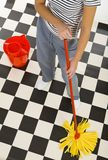 Cleaning floor. Woman standing with mop beside red bucket. View on down parts woman's body. High angle view. White background stock images