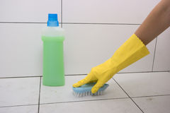Cleaning floor in the bathroom. Royalty Free Stock Image