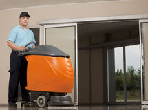 Cleaning floor with big machine Stock Photography