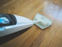 Steam cleaner. Cleaning the floor with a dry steam cleaner royalty free stock images