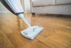 Steam cleaner. Cleaning the floor with a dry steam cleaner stock photos