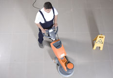 Cleaning floor with machine royalty free stock image