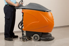 Cleaning floor with machine Stock Images