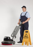 Cleaning floor with machine Royalty Free Stock Images