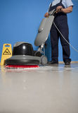 Cleaning floor with machine stock photography