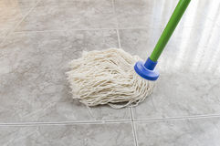 Cleaning the floor marble Royalty Free Stock Photo