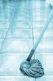 Cleaning the floor with mop. Mop on the floor_blue colored picture royalty free stock photos