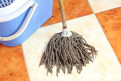 Cleaning floor with mop Royalty Free Stock Images