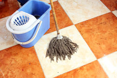 Cleaning floor with mop. Cleaning floor with old mop Royalty Free Stock Photography