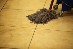 Cleaning the floor with a mop Royalty Free Stock Photography
