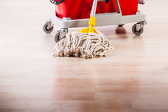 Cleaning the floor with mop Stock Photos