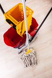 Cleaning floor with mop Stock Photo